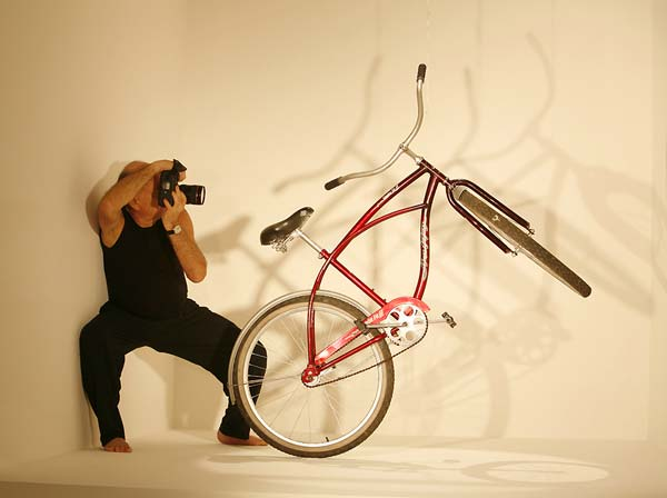 Adi Da Samraj photographing a bicycle